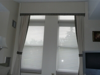 White straight cornice w/plaid banding and matching drapery panels