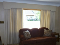 shaped-cornice-with-decorative-cording-and-pinch-pleat-drapery-panels
