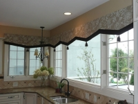 Board mounted Center Point Valances with contrast banding and tassels at points